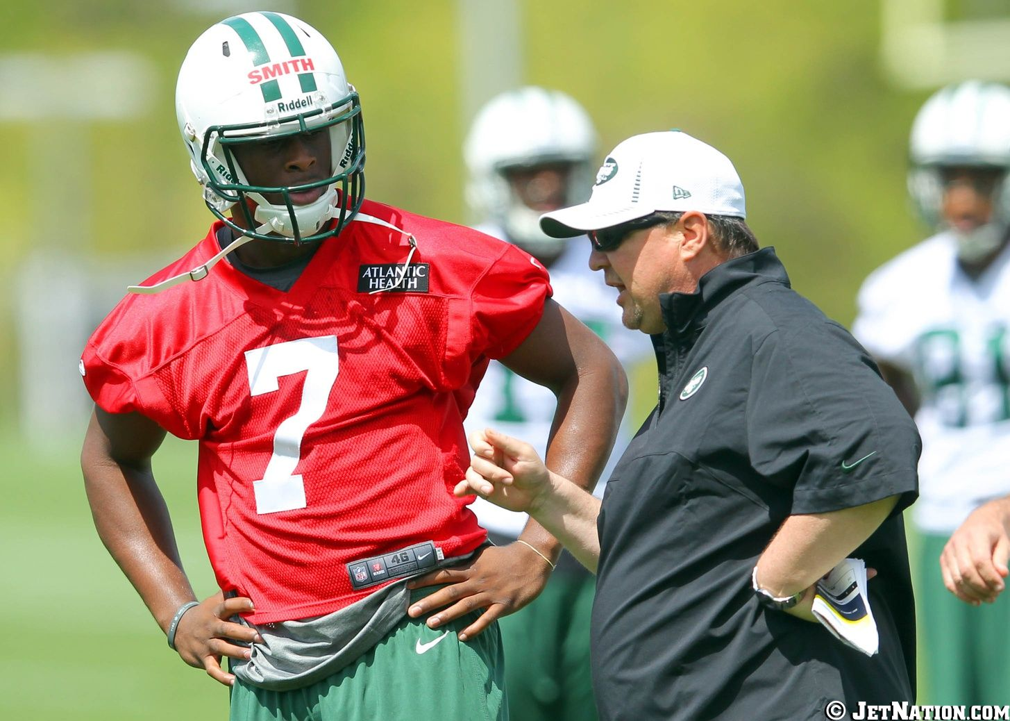 Geno Smith and Marty Mornhinweg