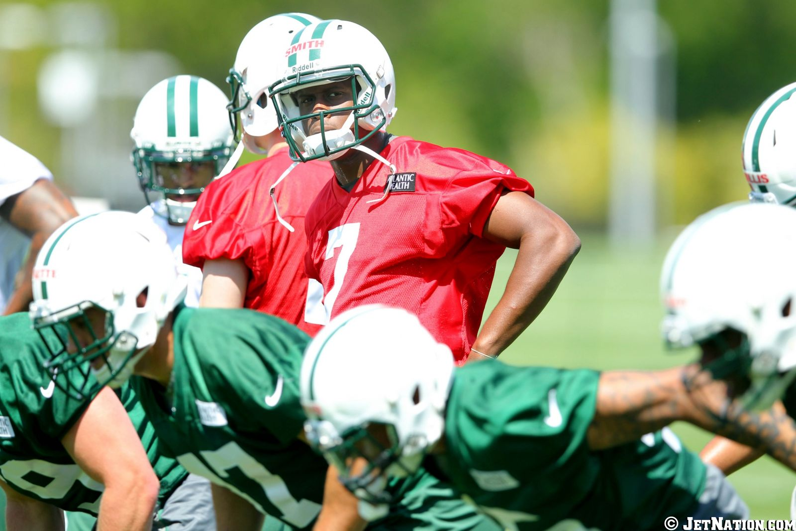Geno Smith gets ready to run a play