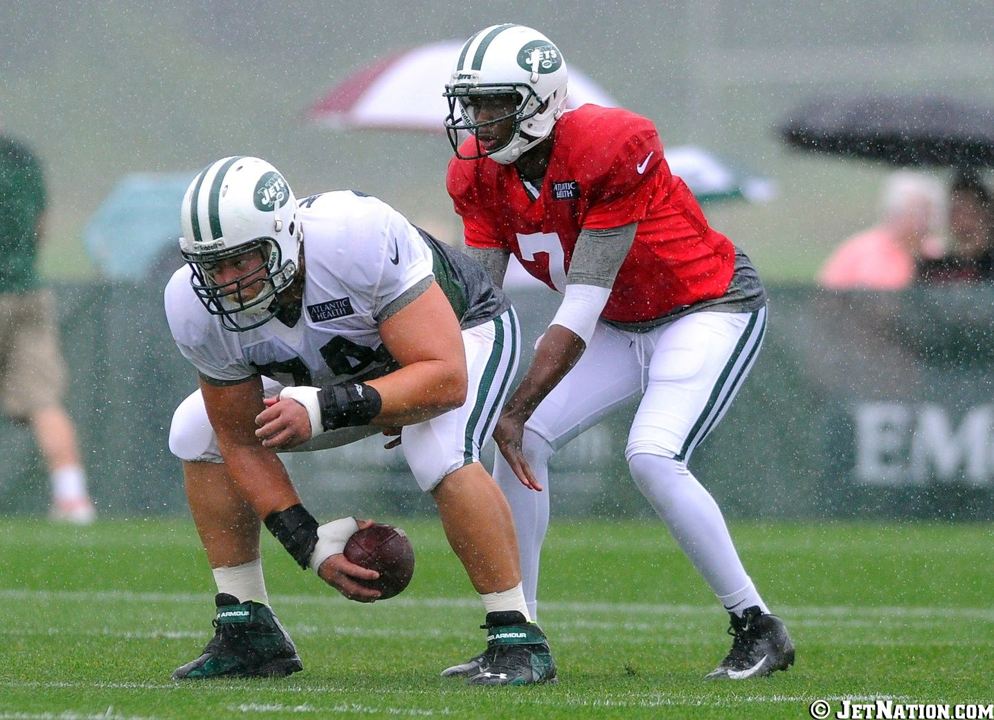 Geno Smith and Nick Mangold