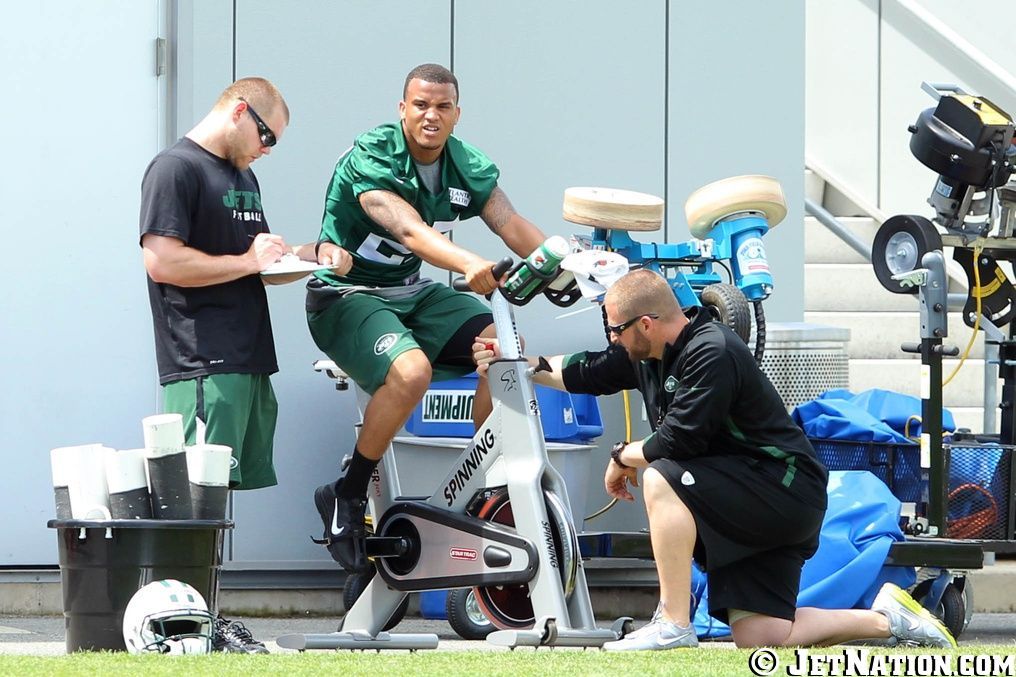 Dee Milliner rides the stationary bike