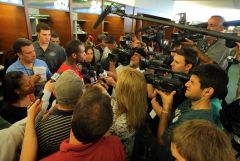 Geno Smith talks to the media