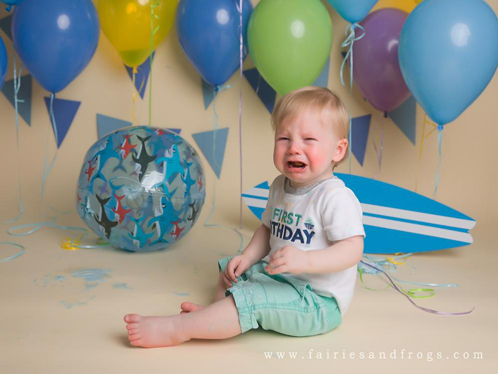 crying-baby-boy-at-his-first-birthday-cake-smash-session.jpg