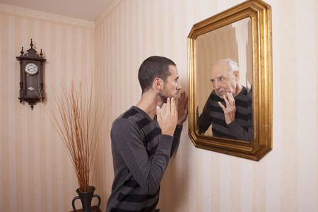 34882269-young-man-looking-at-an-older-himself-in-the-mirror.jpg.ced368a8646c79daf1d93bf0c8437691.jpg